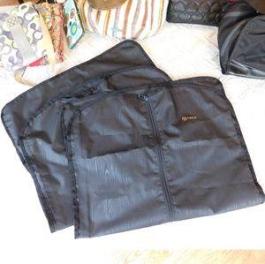 Set of 2 zip up garment bags. Tech brand